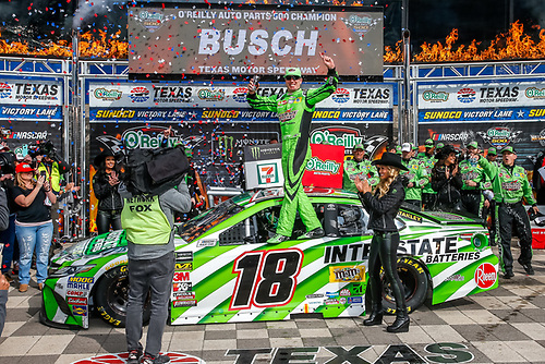 #18: Kyle Busch, Joe Gibbs Racing, Toyota Camry Interstate Batteries in victory lane