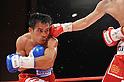 Terdsak Kokietgym (THA),.APRIL 6, 2012 - Boxing :.Takahiro Aou (R) of Japan in action against Terdsak Kokietgym of Thailand during the WBC super featherweight title bout at Tokyo International Forum in Tokyo, Japan. (Photo by Mikio Nakai/AFLO)