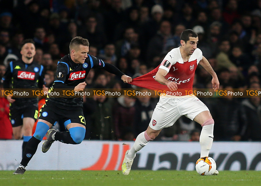 Piotr Zielinski of Napoli pulls the shirt of Arsenal's Henrikh Mkhitaryan during Arsenal vs Napoli, UEFA Europa League Football at the Emirates Stadium on 11th April 2019
