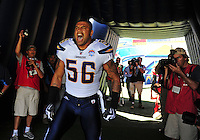 Sep. 20, 2009; San Diego, CA, USA; San Diego Chargers linebacker Shawne Merriman is surrounded by photographers in the tunnel prior to the game against the Baltimore Ravens at Qualcomm Stadium in San Diego. Baltimore defeated San Diego 31-26. Mandatory Credit: Mark J. Rebilas-