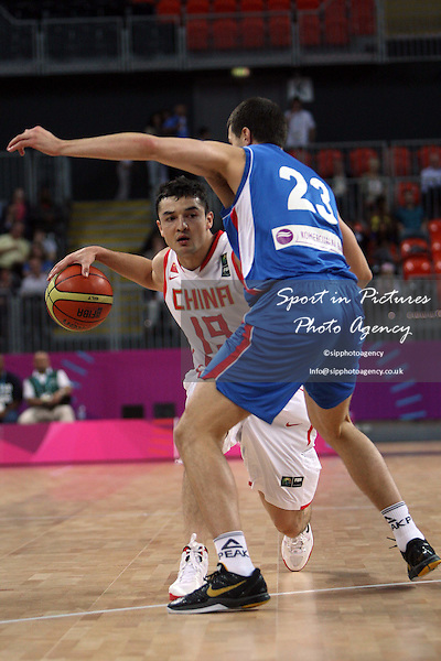 Mugedaer Xirelijiang (China) and Dragan Milosavljevic (Serbia) in action. Serbia v China. The London International Basketball Invitational. London Prepares for Olympics 2012. Basketball Arena, Olympic Park. London. 17/08/2011. MANDATORY Credit Sportinpictures/Paul Chesterton - NO UNAUTHORISED USE - 07837 394578.