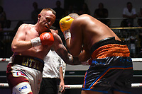 Mark Little (white shorts) defeats Phil Williams during a Boxing Show at York Hall on 29th June 2019