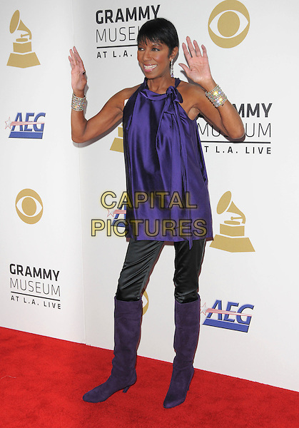 NATALIE COLE <br /> attends The GRAMMY Nominations Concert Live!! held at Nokia Theatre L.A. Live in Los Angeles, California on December 3rd 2008.<br /> full length bag knee high boots purple silk satin top hands<br /> CAP/DVS<br /> &copy;Debbie VanStory/Capital Pictures