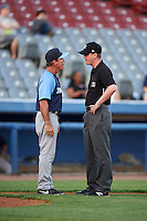 Trenton Thunder manager Bobby Mitchell (7) argues a call with umpire Ryan Wills during the second game of a doubleheader against the Hartford Yard Goats on June 1, 2016 at Sen. Thomas J. Dodd Memorial Stadium in Norwich, Connecticut.  Trenton defeated Hartford 2-1.  (Mike Janes/Four Seam Images)