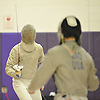Donal Mahoney of Garden City, left, battles Patrick Gao of Great Neck North during the Nassau County boys' fencing saber final at Oyster Bay High School on Saturday, Jan. 30, 2016. Gao won 15-11 to claim the county title.