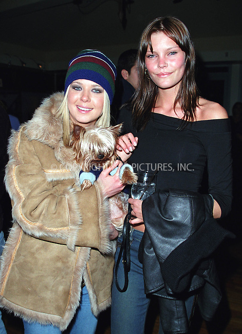 """Actress TARA REID holding MAY ANDERSEN'S dog """"Macumba"""" at the Westminster Kennel Club's Tea and Biscuits Benefit to honor the search and rescue dogs and their handlers who risked their lives at Ground Zero in the heroic efforts that took place following the World Trade Center tragedy. The American Park Restaurant in New York. February 6, 2002.  © 2002 by Alecsey Boldeskul/NY Photo Press.     ....*ONE-TIME REPRODUCTION RIGHTS*      ....NY Photo Press:  ..phone (646) 267-6913;   ..e-mail: info@nyphotopress.com"""