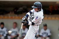 03 october 2009: Joris Bert of Rouen makes contact during game 1 of the 2009 French Elite Finals won 6-5 by Rouen over Savigny in the 11th inning, at Stade Pierre Rolland stadium in Rouen, France.