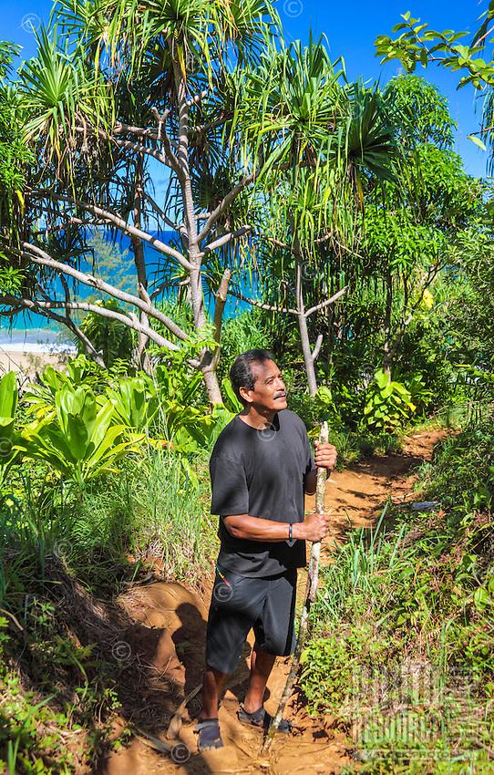A Hawaiian man from O'ahu appreciates beauty along the Kalalau Trail near Hanakapi'ai Beach, Kaua'i.