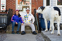 Carlos Arredondo, 57, (right) and his wife Melida Arredondo, 52, are seen in their front yard in Roslindale, Boston, Massachusetts, USA, on Sat., March 31, 2018. Arredondo is well known as the &quot;man in the cowboy hat&quot; who helped out in the aftermath of the Boston Marathon Bombing in 2013. Carlos is wearing a jacket that he has used to create a t-shirt design for when he runs the Boston Marathon later this year. Though he has run the race unofficially previously, this will be the first time he runs it &quot;legally,&quot; he says. <br /> <br /> Their dog, Buddy, age 18, can also be seen. Carlos says he often accidentally calls Buddy by his son's name, Brian. Brian Arredondo died by suicide in 2011 after a battle with depression following the 2004 death of Arrendondo's other son  Marine Lance Corporal Alexander Scott Arredondo, who was killed while serving in Iraq.