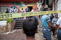 "June 15, 2018: A young kid watches the crime scene where Luis Antonio Terrazas Valente ""Toño"" (not-pictured), communal land chief of police was murdered by gunmen in La Sabana, a violence-plagued neighbourhood in the outskirts of Acapulco, Guerrero. On that particular bloody day six killings were reported related to crime violence."