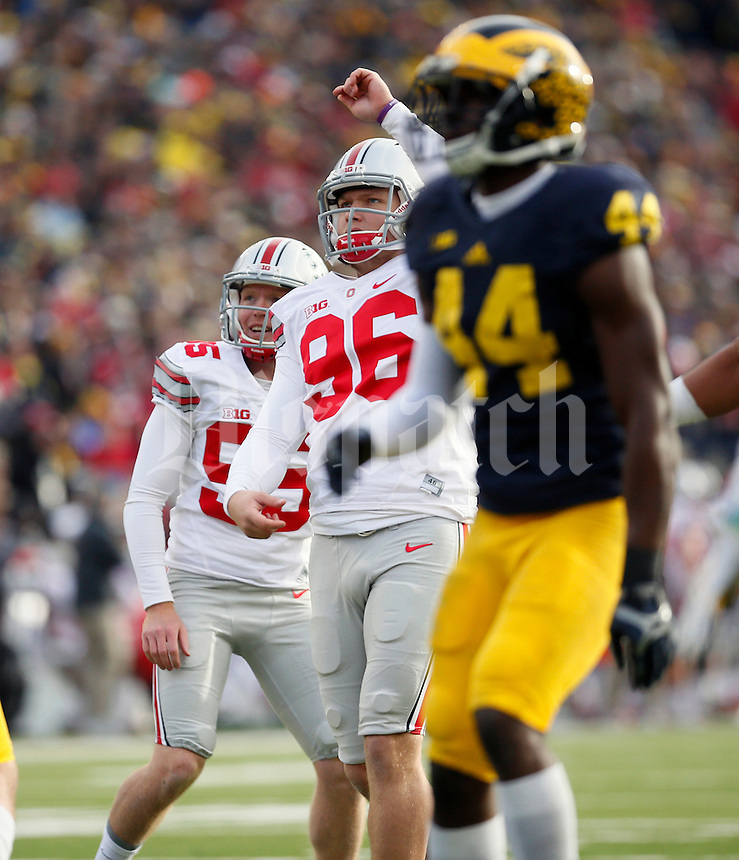 Ohio State Buckeyes place kicker Sean Nuernberger (96) and punter Cameron Johnston (95) against Michigan Wolverines at Michigan Stadium in Arbor, Michigan on November 28, 2015.  (Dispatch photo by Kyle Robertson)
