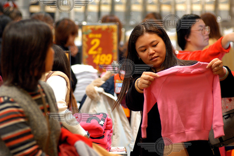 Shoppers in a clothes store in the Taipei 101 mall.