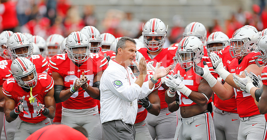 Ohio State University head coach fires up the players before their game against Western Michigan at Ohio Stadium on September 26, 2015. (Chris Russell/Dispatch Photo)