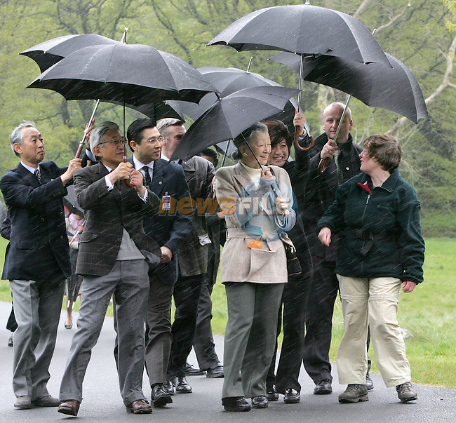 COUNTY WICKLOW, IRELAND - MAY 8: Emperor Akihito, the 125th Emperor of Japan, and Her Imperial Majesty Michoko, Empress of Japan, fight the wind and driving rain as they take a stroll during a visit to the Glendalough National Park, May 8, 2005, in County Wicklow, Ireland. The royal couple are on a three-day visit to Ireland..Photo AFP/NEWSFILE/FRAN CAFFREY..(Photo credit should read AFP Photo FRAN CAFFREY/NEWSFILE)...This Picture has been sent you under the condtions enclosed by:.Newsfile Ltd..the Studio,.Millmount Abbey,.Drogheda,.Co Meath..Ireland..Tel: +353(0)41-9871240.Fax: +353(0)41-9871260.GSM: +353(0)86-2500958.email: pictures@newsfile.ie.www.newsfile.ie.FTP: 193.120.102.198..This picture is from Fran Caffrey@newsfile.ie