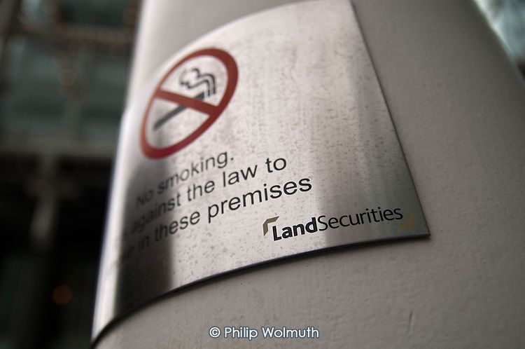 No Smoking sign in an outdoor open space at Cardinal Walk, Victoria, London, an office and retail development owned by Land Securities and patrolled by private security guards.