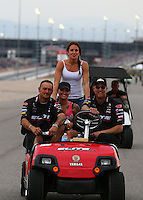 Mar 29, 2014; Las Vegas, NV, USA; Crew members for NHRA pro stock driver Erica Enders-Stevens after winning the K&N Horsepower Challenger during the Summitracing.com Nationals at The Strip at Las Vegas Motor Speedway. Mandatory Credit: Mark J. Rebilas-