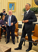 United States President Barack Obama (R) and Prime Minister Haider al-Abadi of Iraq stand up after a bilateral meeting in the Oval Office of the White House, April 14, 2015, in Washington, DC. The leaders discussed the strategic partnership between the two countries, support in fighting ISIL as well as commercial and cultural relations.    <br /> Credit: Mike Theiler / Pool via CNP