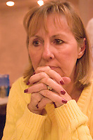 Thoughtful woman waiting for dinner in a restaurant.  Indian Shores Tampa Bay Area Florida USA