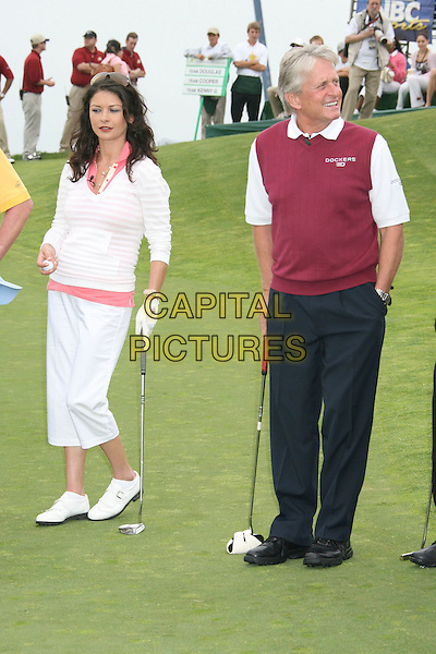 CATHERINE ZETA-JONES & MICHAEL DOUGLAS.9th Annual Michael Douglas & Friends Celebrity Golf Event.held at the Trump National Golf Club, Rancho Palos Verdes, California, USA. .April 29th, 2007.sport full length white pink striped stripes top cropped beige trousers married husband wife couple black beige vest sleeveless jumper hand in pocket.CAP/ADM/RE.©Russ Elliot/AdMedia/Capital Pictures