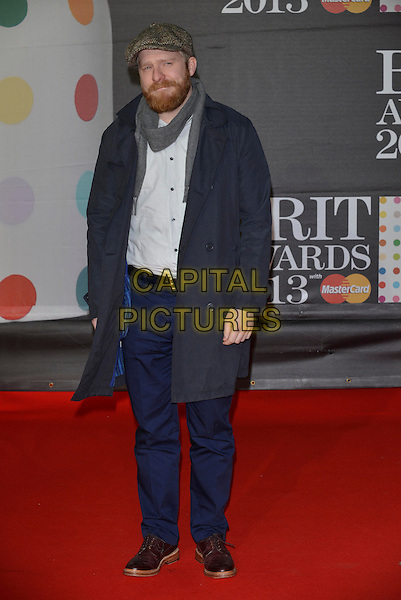 Alex Clare.The Brit Awards 2013 arrivals at the O2, Greenwich, London, England 20th February 2013.The Brits full length cap hat tweed blue trousers coat white shirt grey gray scarf beard facial hair .CAP/PL.©Phil Loftus/Capital Pictures.