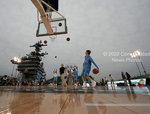 The University of North Carolina basketball team practices Thursday, November 10, 2011 in the basketball arena on the flight deck aboard the Nimitz-class aircraft carrier USS Carl Vinson (CVN 70) in San Diego, California. Carl Vinson is hosting Michigan State University and the University of North Carolina for the inaugural Quicken Loans Carrier Classic basketball game on Veteran's Day, November 11.  United States President Barack Obama and first lady Michelle Obama are scheduled to attend the game..Mandatory Credit: James R. Evans - U.S. Navy via CNP