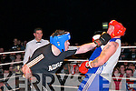 Rumble in Listowel : Derek Dalton receives a punch in the chin from Coilin McCarthy in their heavyweight encounter  in the white collar boxing charity event organized by the Kerry Crusaders in The Listowel Community Centre on Friday night last.