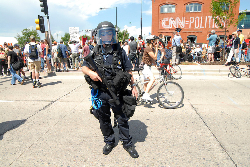 24 Aug 08: A police officer is outfitted with riot gear outside the Pepsi Center. On the day before the Democratic National Convention is scheduled to begin about 1,500 people participated in the ReCreate 68 rally, which included a march from the Colorado state capitol building to the Pepsi Center.