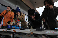 People call relatives using especially installed lines town of Natori, after the earthquake and tsunami knocked out all mobile communications lines.  The Tsunami devastated ahe entire pacifc coastline of Japan after the earthquake and tsunami devastated the area Sendai, Japan. One of the biggest earthquakes ever recorded struck off the coast of Japan on 11 Mar 2011 had killed thousands of people. The death toll was expected to rise dramatically, with tens of thousands reported missing..14 Mar 2011...