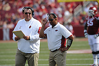 NWA Democrat-Gazette/ANDY SHUPE<br /> Arkansas coach Bret Bielema speaks with receivers coach Michael Smith against University of Texas at El Paso's Saturday, Sept. 5, 2015, during the third quarter of play in Razorback Stadium in Fayetteville. Visit nwadg.com/photos to see more from the game.
