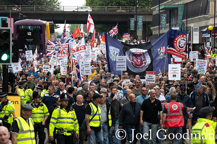 © Joel Goodman - 07973 332324 . 02/06/2018. Manchester, UK . Approximately 1,000 DFLA supporters march along Oxford Road in Manchester City Centre . The Democratic Football Lads Alliance demonstrate in Manchester , eleven days after the first anniversary of the Manchester Arena terror attack . Photo credit : Joel Goodman