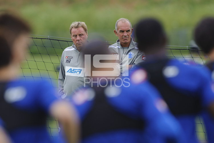 QPR manager Harry Redknapp and assistant Joe Jordan watch the team train
