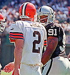 Oakland Raiders vs. Cleveland Browns at Oakland Alameda County Coliseum Sunday, September 24, 2000.  Raiders beat Browns  36-10.  Oakland Raiders defensive end Regan Upshaw (91) give a look toward Cleveland Browns quarterback Tim Couch (2).