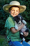 Little cowpoke with his puppy, San Luis Obispo, California