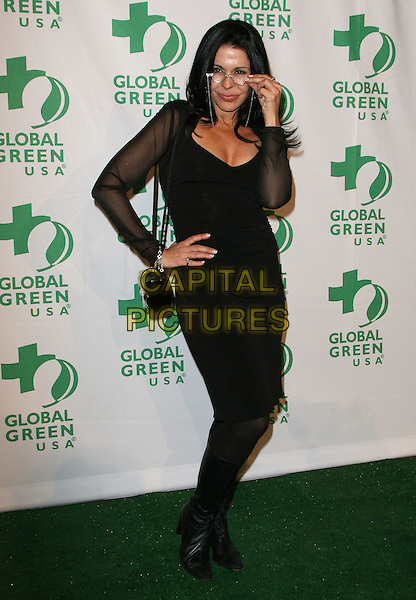 Maria Conchita Alonso.Global Green USA's 9th Annual Pre-Oscar Party held at the Avalon, Hollywood, California, USA..February 22nd, 2012.full length black dress sheer sleeves hand on hip boots glasses.CAP/ADM.©AdMedia/Capital Pictures.