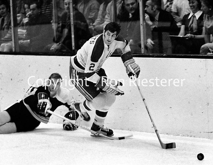 Seals Doug Roberts against Boston's Wayne .Carlton (1971 photo by Ron Riesterer)