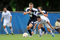 10 September 2011:  FIU's Quentin Albrecht (22) breaks away from Stetson's Chris Aguirre (15) on his way to scoring a goal in the first half as the FIU Golden Panthers defeated the Stetson University Hatters, 3-2 in the second overtime period, at University Park Stadium in Miami, Florida.