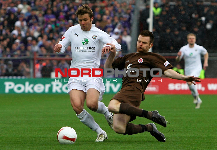 2.Liga 2007/2008  31. Spieltag Rueckrunde<br /> FC St.Pauli &ndash; vs. FC Erzgebirge Aue 4:2<br /> <br /> Linksverteidiger Biermann (Nr.22) ersetzte heute souver&auml;n Ralph Gunesch in der Verteidigung. Hier wird Florian Heller (Nr.11) abgegr&auml;tscht.<br /> <br /> <br /> Foto &copy; nph (nordphoto)<br /> <br /> *** Local Caption ***