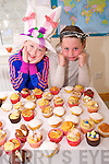 Aliyah Connolly and Saoirse Breen enjoying the Mad Hatter's Tea Party and cake sale in aid of Temple Street Hospital at the Shanakill Family Resource Centre on Thursday.