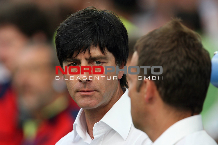 UEFA Euro 2008 Semi-Finals Match 29 Basel - St. Jakob-Park. Deutschland ( GER ) - T&uuml;rkei ( TUR ) 3:2 ( 1:1 ). <br /> Joachim Loew (L&ouml;w) - ( Germany / Trainer / Coach ) .<br />  und Hans-Dieter Flick ( Germany / Co-Trainer / Coach ) (l-r) schauen sich an. Foto &copy; nph (  nordphoto  )