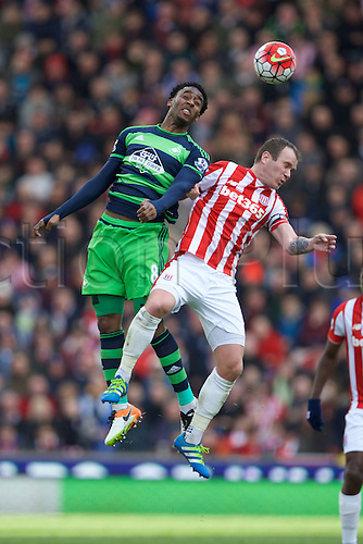 02.04.2016. Britannia Stadium, Stoke, England. Barclays Premier League. Stoke City versus Swansea City.  Swansea City midfielder Leroy Fer and Stoke City midfielder Glenn Whelan jump for the ball.