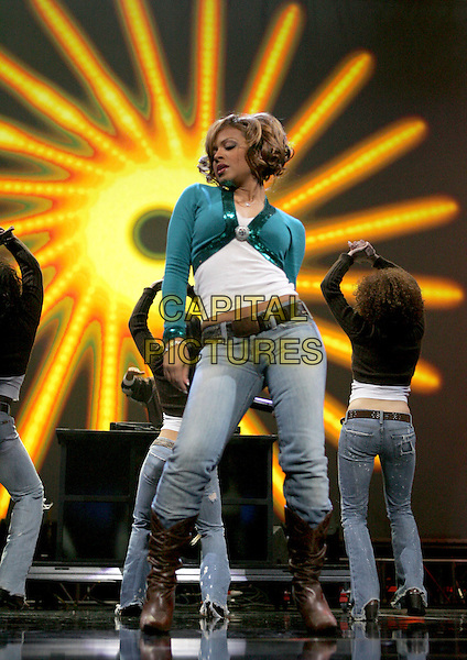 CHRISTINA MILIAN.Performs live at 102.7Õs KIIS-FMÕs 4th Annual Jingle Ball held at The Pond of Anaheim in Anaheim, California, USA, December 4th 2004..full length gig on stage concert green turquoise short cropped cardigan sequined brooch broach white top jeans tucked in brown knee high boots .Ref: DVS.www.capitalpictures.com.sales@capitalpictures.com.©Capital Pictures.