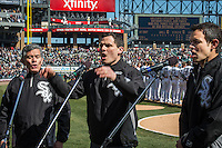 The Ponce family, father Phil, left, Anthony, center, and Dan sing the national anthem at the White Sox home opener