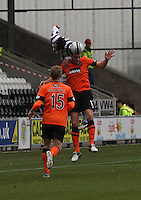 Steven Thompson climbs over Keith Watson to win the aerial ball in the St Mirren v Dundee United Clydesdale Bank Scottish Premier League match played at St Mirren Park, Paisley on 27.10.12.