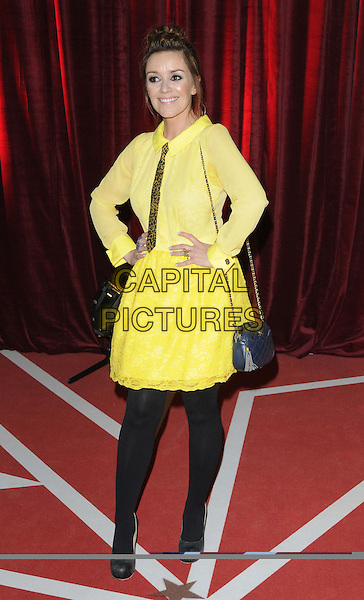 Zoe Henry.attended the British Soap Awards 2013, Media City, Salford, Manchester, England, UK, 18th May 2013..arrivals full length yellow shirt tie dress skirt hands on hips black tights   bag chanel navy blue leopard print animal .CAP/CAN.©Can Nguyen/Capital Pictures.