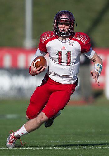 November 29, 2013:  Miami (OH) quarterback Austin Gearing (11) runs with the ball during NCAA Football game action between the Miami (OH) Redhawks and the Ball State Cardinals at Scheumann Stadium in Muncie, Indiana.  Ball State defeated Miami (OH) 55-14.