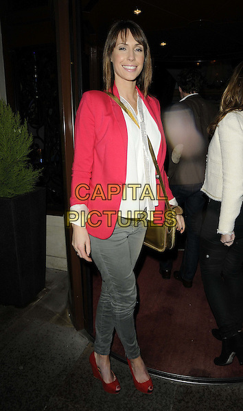 Alex Jones.attended the BoxNation new television boxing channel launch party, Sanctum Soho Hotel,  Warwick St., London, England, UK, 5th May 2012..full length red jacket grey gray trousers peep toe shoes wedges white shirt .CAP/CAN.©Can Nguyen/Capital Pictures.