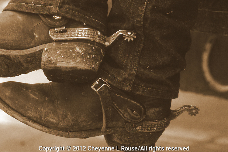 Old dusty cowboy boots and spurs - Utah (sepia toned)