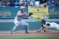 Dempsey Grover (20) of the UC Santa Barbara Gauchos waits for the throw home as Luke Rasmussen (44) of the Cal State Long Beach Dirtbags slides into home plate during a game at Blair Field on April 1, 2016 in Long Beach, California. UC Santa Barbara defeated Cal State Long Beach, 4-3. (Larry Goren/Four Seam Images)