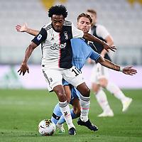 20th July 20202, Allianz Stadium, Turin, Italy; Serie A football league, Juventus versus Lazio; Juan Cuadrado is challenged by Ciro Immobile