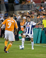Pachuca FC defender Fausto Pinto passes around Houston Dynamo midfielder Brian Mullan (9).  Houston Dynamo defeated Pachuca FC 2-0 in the semifinals of the Superliga 2008 tournament at Robertson Stadium in Houston, TX on July 29, 2008.
